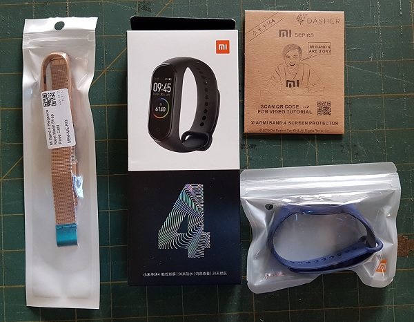 Mi Band 4 with Blue and Metal Mest Rose Gold Strap